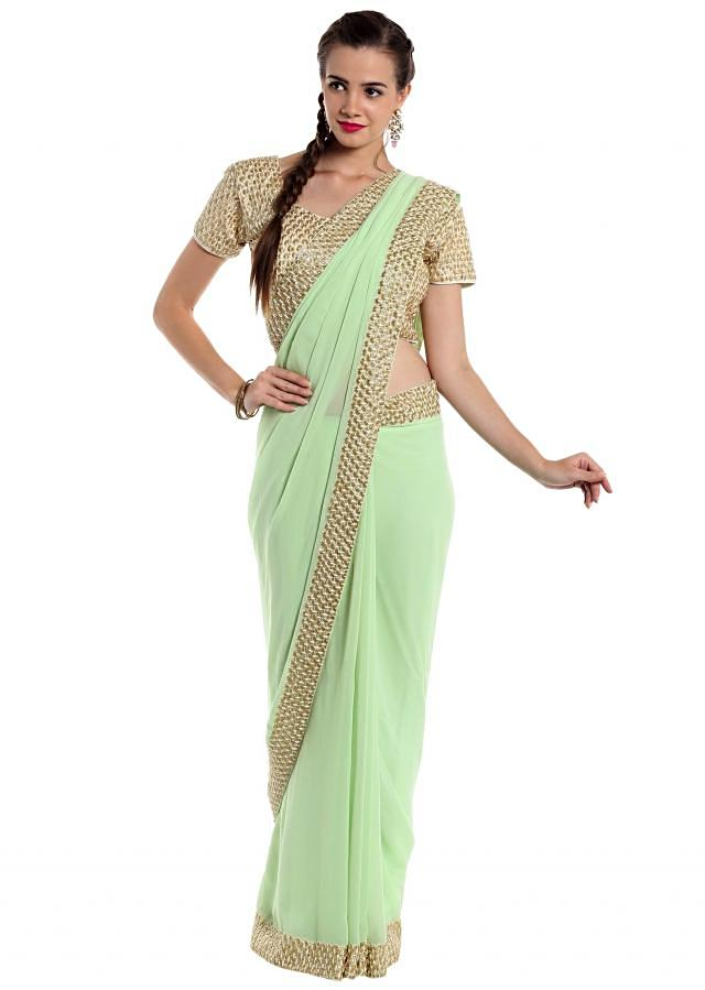 Mint green georgette saree crafted with cut dana border only on Kalki