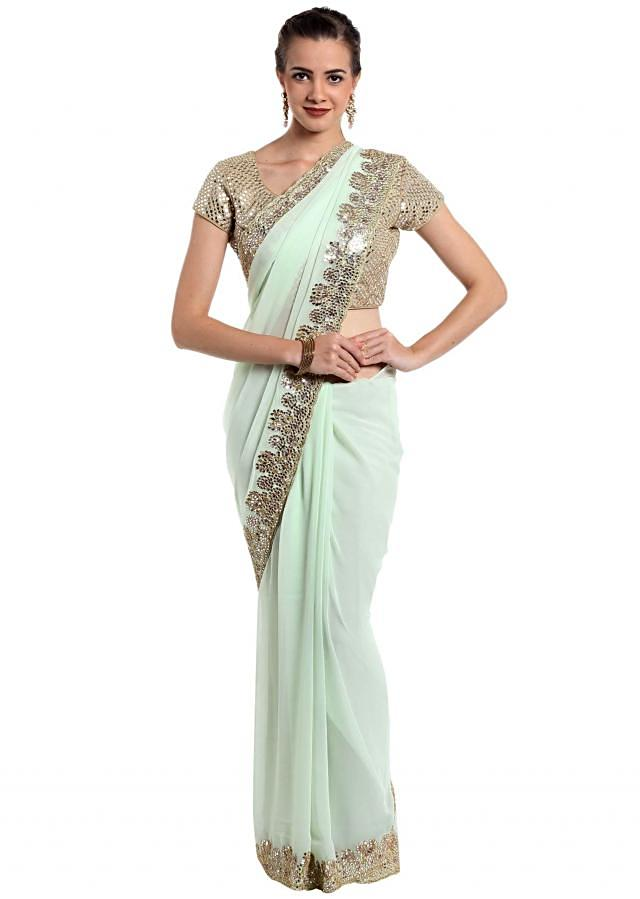Mint green georgette saree with mirror work and cut dana only on Kalki