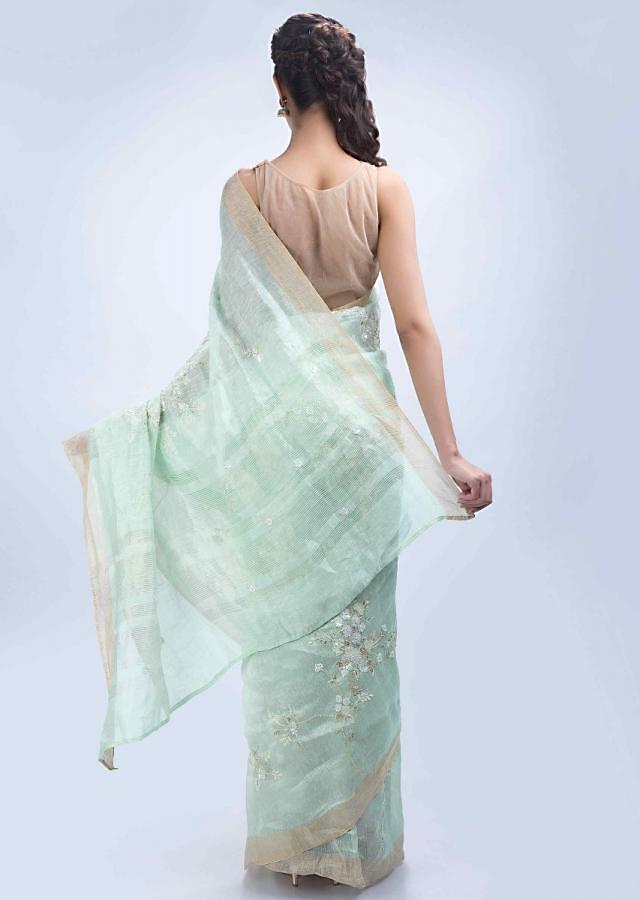 Mint green linen saree with floral jaal embroidery only on Kalki