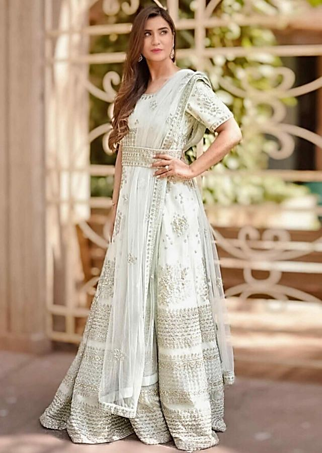 Mint green net anarklai suit with sequins and cut dana embellishment only on Kalki