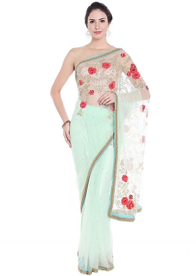 Mint green net saree in embossed resham embroidery only on Kalki