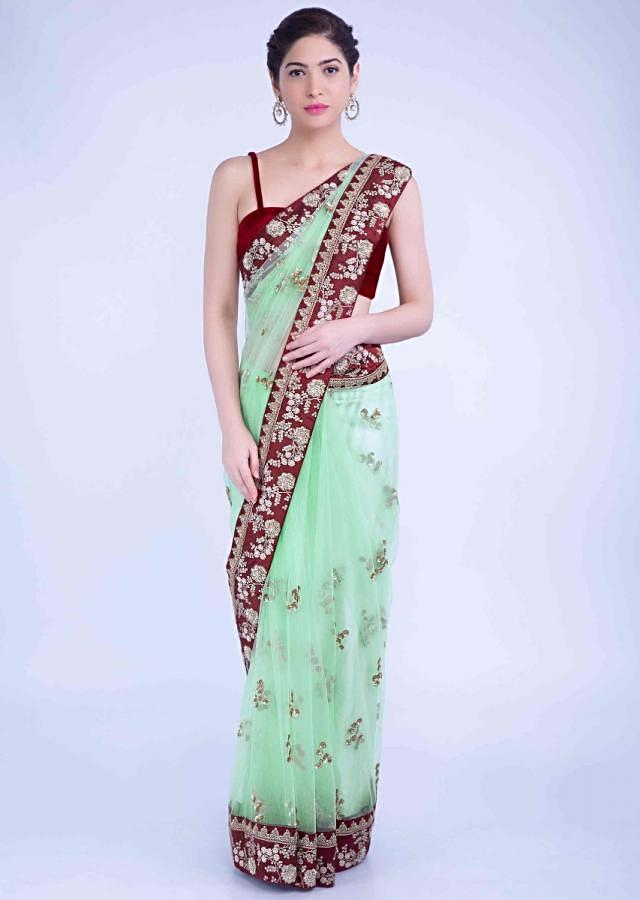 Mint Green Saree In Net With Red Raw Silk Embellished Border Online - Kalki Fashion