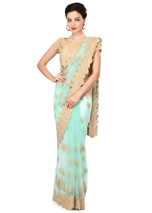 Mint green saree enhanced in thread embroidery only on Kalki