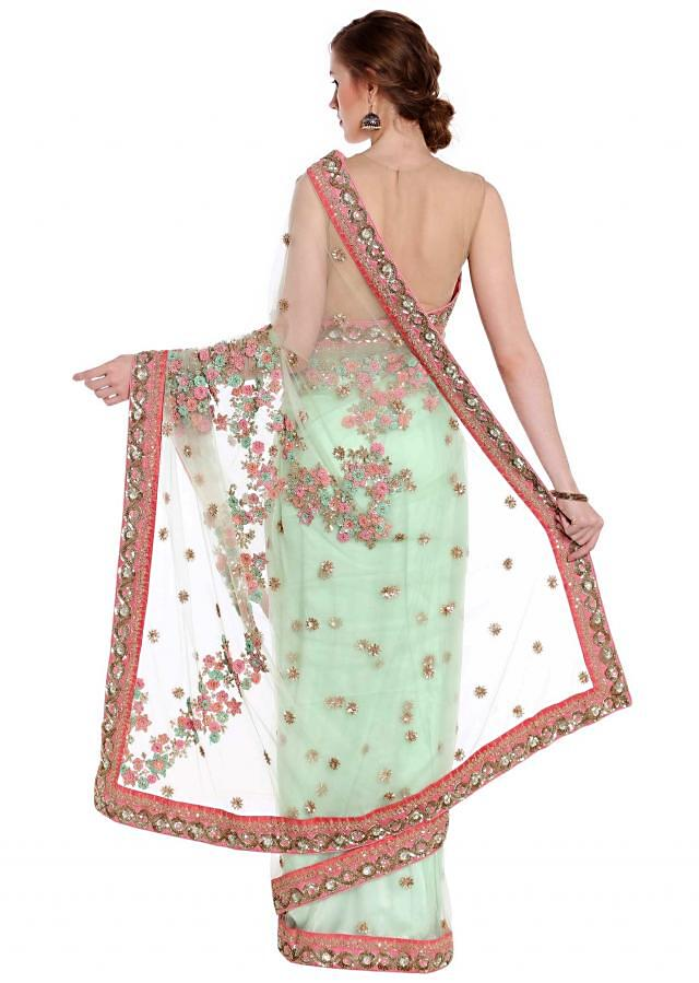 Mint green saree in net with french knot floral embroidery only on Kalki