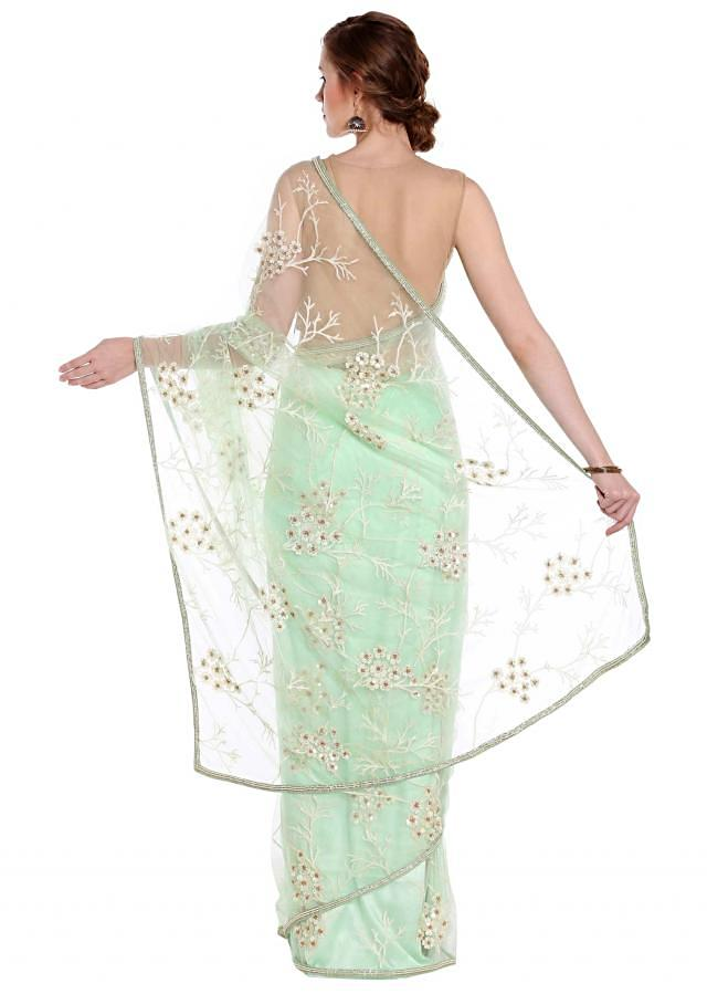 Mint green saree in net with silver zari and sequin work only on Kalki