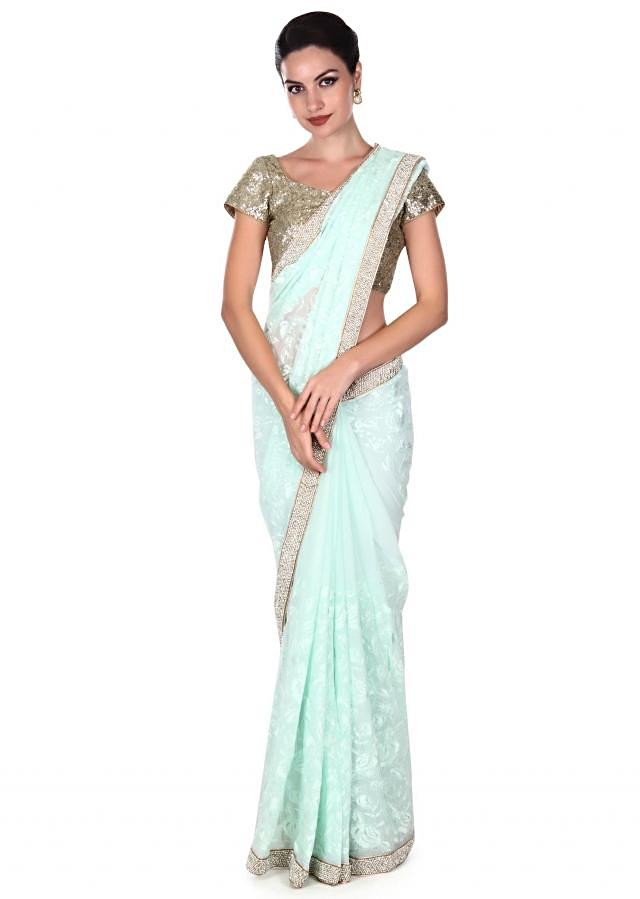 Mint green saree in resham and pearl border only on Kalki