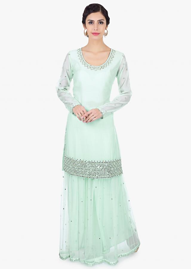 Mint green satin net sharara paired with a matching georgette suit only on Kalki