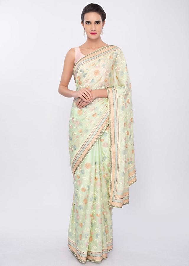 Mint green satin silk saree in multi color floral thread embroidered jaal work only on Kalki