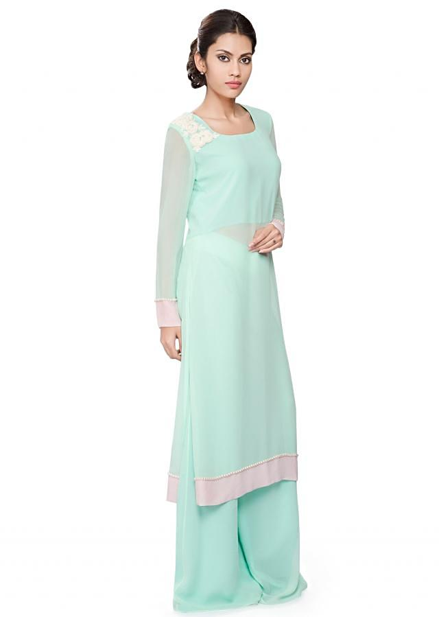 Mint green tunic with off white embroidery