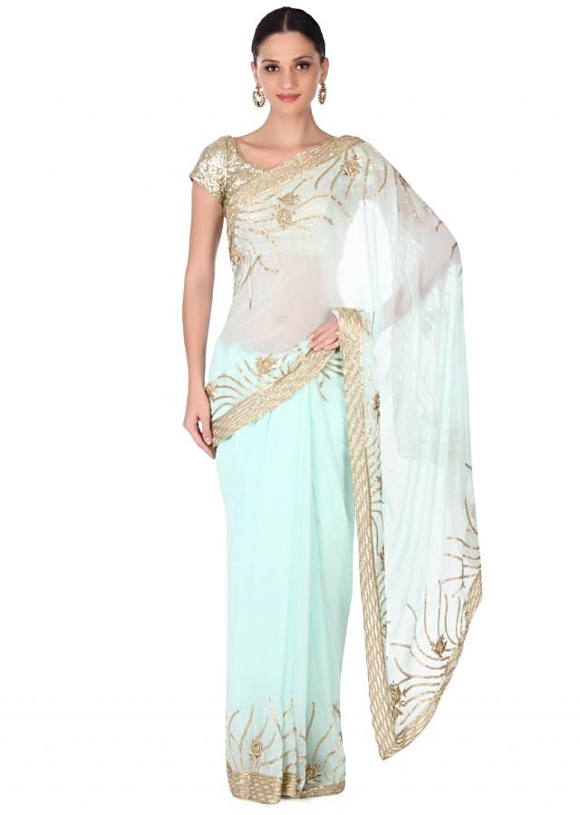 Mint saree adorn in gold embroidered border only on Kalki