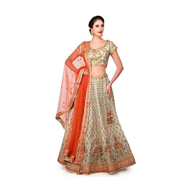 Mint blue lehenga in raw silk enhanced in zari patchwork embroidery only on Kalki