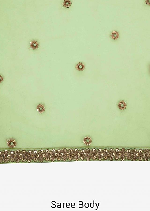 Mint blue saree with a fancy cape embellished in resham and zari embroidery work only on Kalki