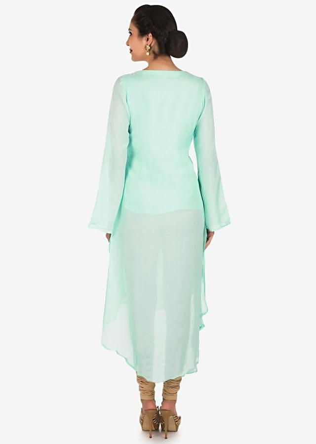 Mint green kurti in cotton adorn in french knot floral motif embroidery only on Kalki