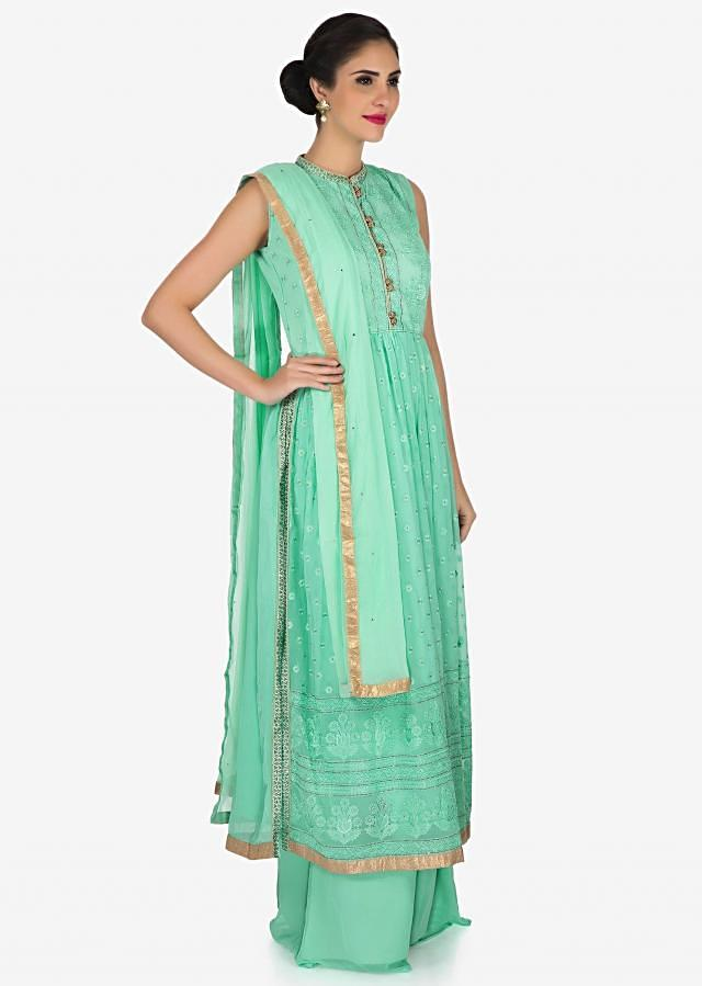 Mint green palazzo suit in georgette beautified in resham and kundan embroidery work only on Kalki