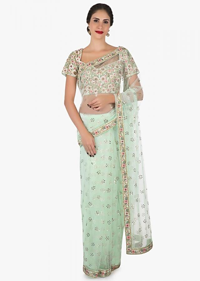 Mint green saree in net featuring the able embroidery work only on Kalki