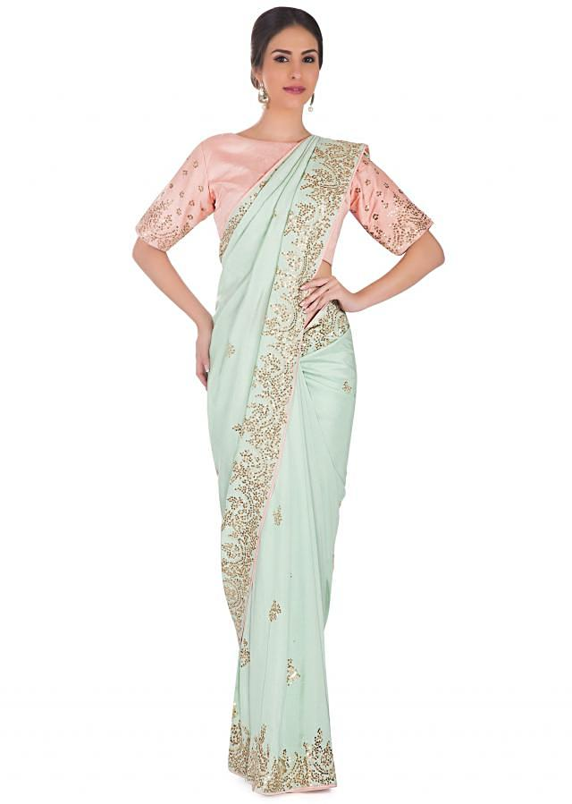 Mint Green Saree In Satin And Pink Pre-Stitched Silk Blouse Adorned With Zari, Sequin Border And Butti Online - Kalki Fashion