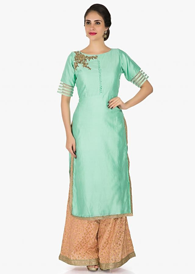 Mint green silk palazzo suit beautified with zardosi and sequin work only on Kalki