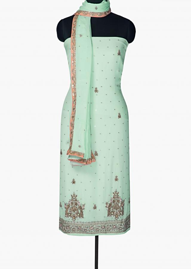 Mint green unstitched suit with zardosi and french knot only on Kalki