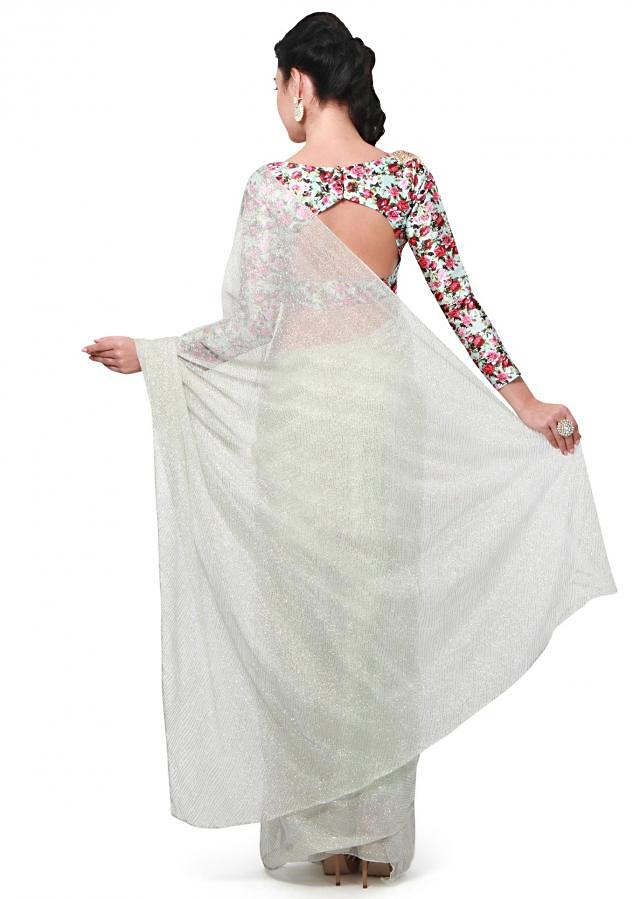 Mint saree featuring in shimmer net. Matched with ready blouse in floral printed silk with embroidered butti n kardana.