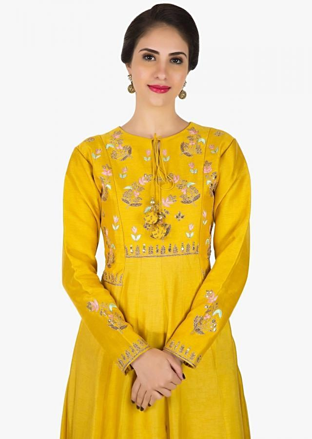 Yellow silk anarkali suit embellished in resham and gota patch work only on Kalki