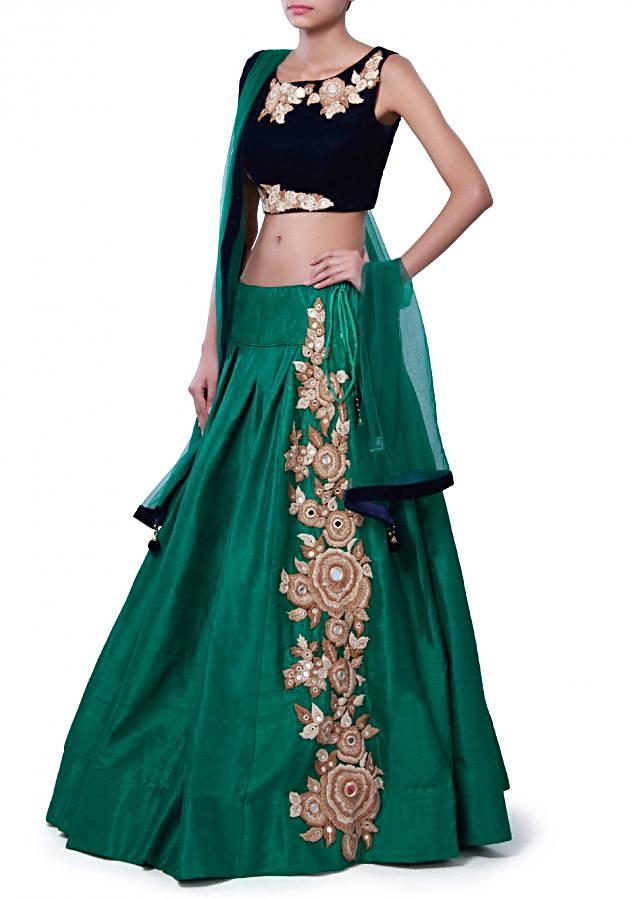 Moss green lehenga adorn in zari and mirror embroidery only on Kalki