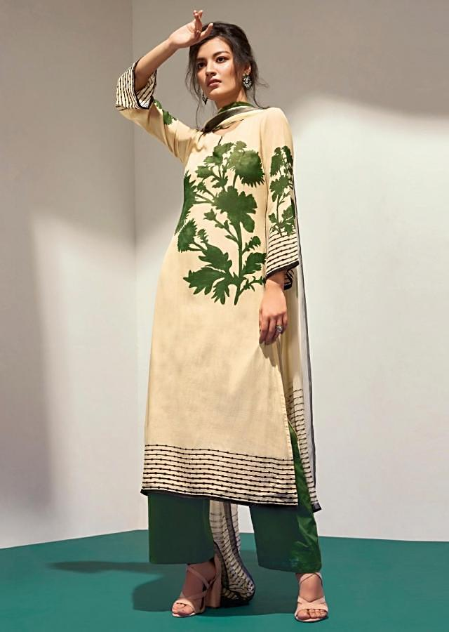 Moss green and cream unstithced suit with floral pritned hem line and sleeveonly on Kalki