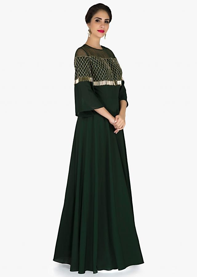 Moss green dress in georgette with cut dana and tassel work only on Kalki