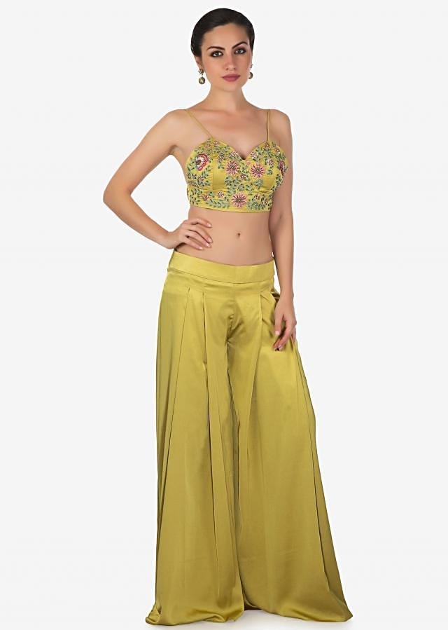 Moss green palazzo set in resham embroidery matched with fancy jacket only on Kalki