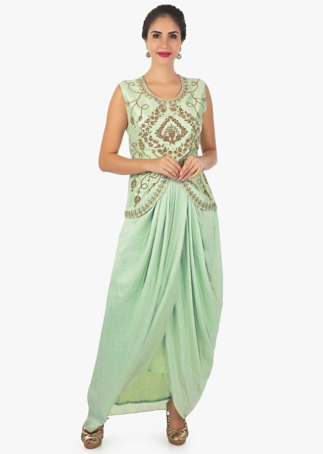 Mud green raw silk crepe dress  paired with a asymmetric jacket only on Kalki