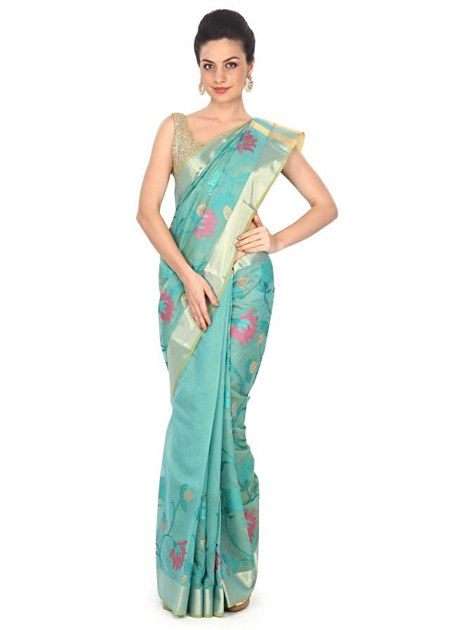 Mud green saree adorn in lotus motif embroidery only on Kalki