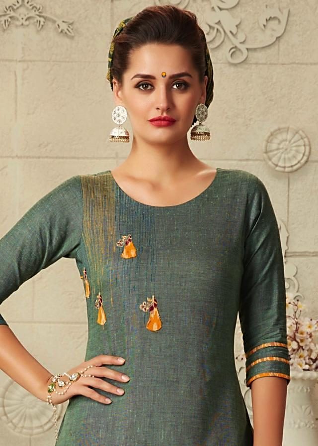 Mud green A line suit with front short and back long matched with ikkat printed salwar only on Kalki