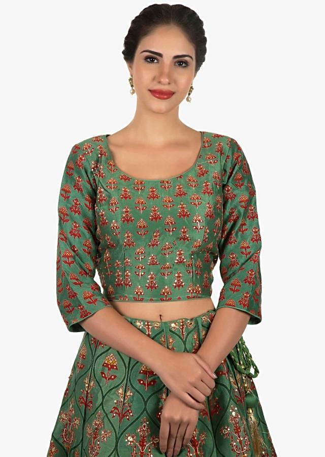 Mud green lehenga in cotton silk highlighted with beautiful prints and sequin work only on Kalki