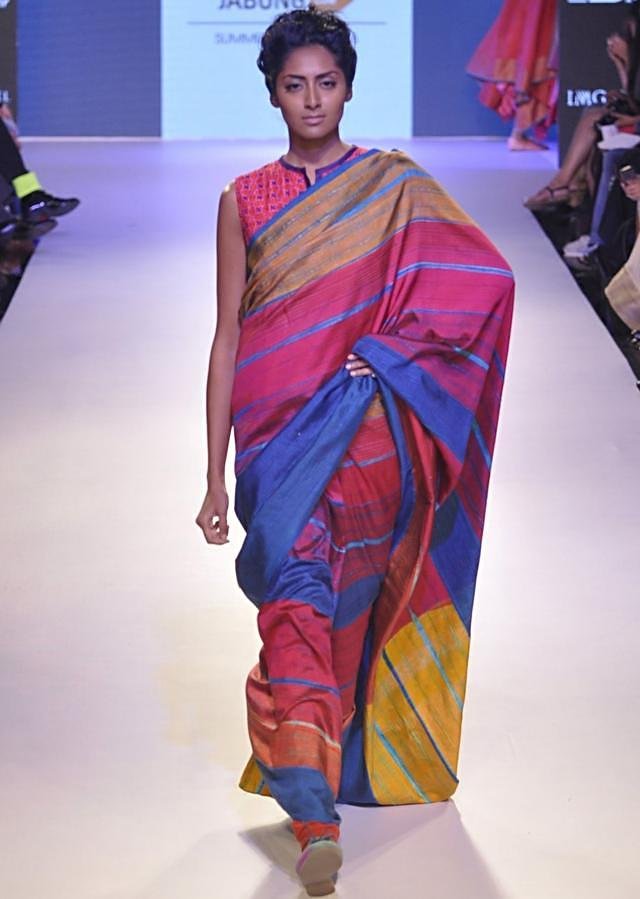 Model walks the ramp in multi color saree for Krishna Mehra