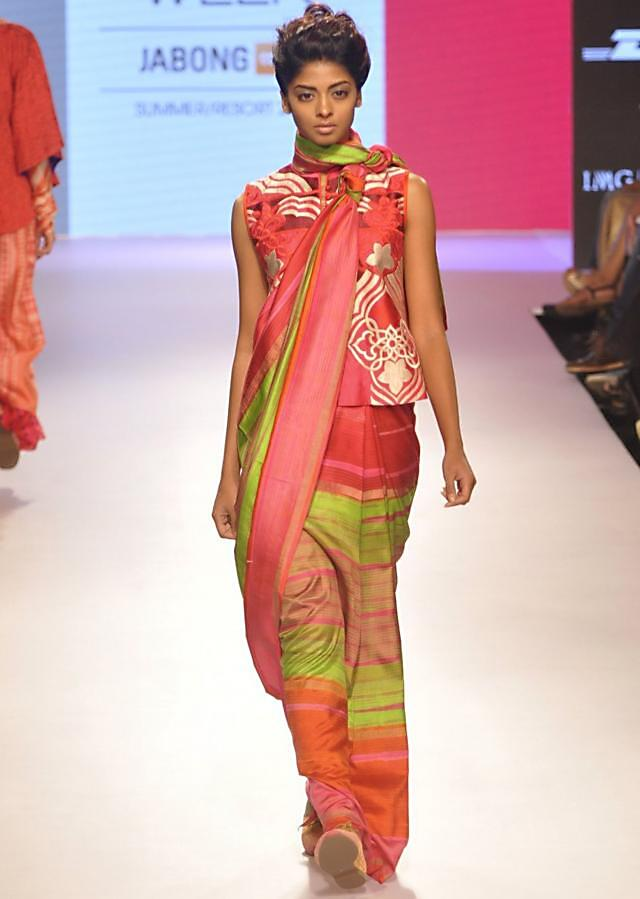 Model walks the ramp in multi color saree with long blouse for Krishna Mehra