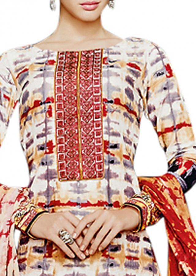 Multi color unstitched suit enhanced in resham and print
