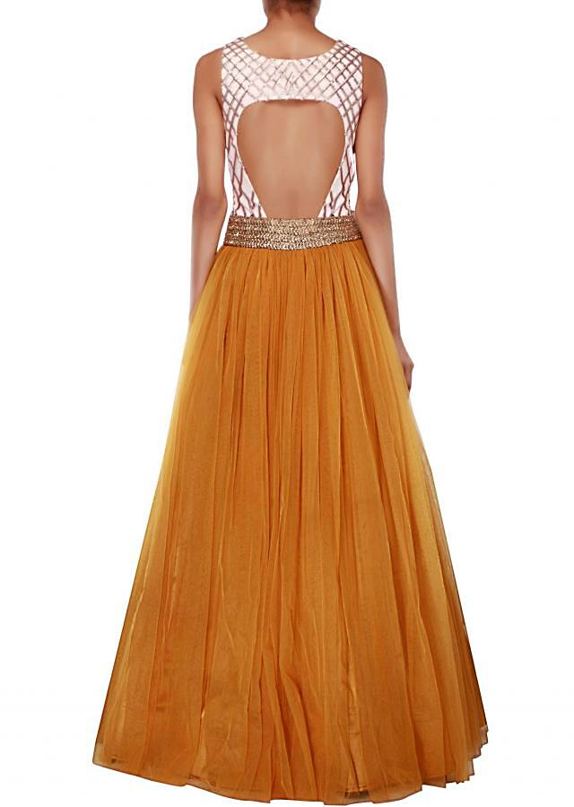 Mustard and pink suit adorn in sequin and zardosi embroidery only on Kalki