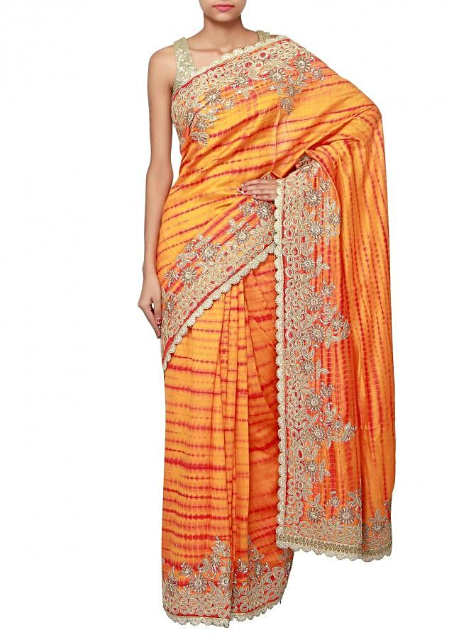 Mustard and rust saree enhanced in applique embroidery only on Kalki