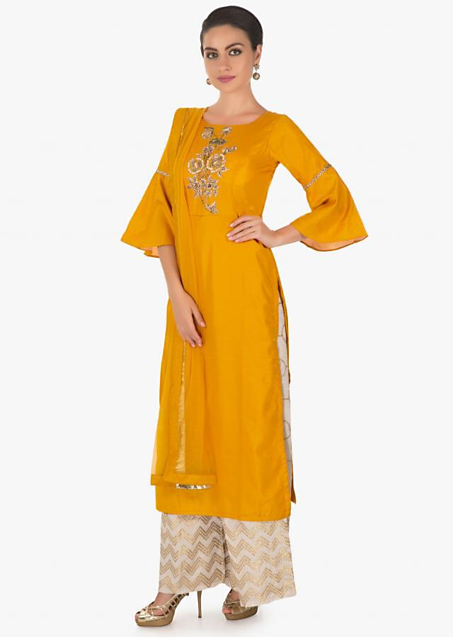 Mustard cotton silk kurti in zari matched with cream silk pant in zari motifs only in kalki