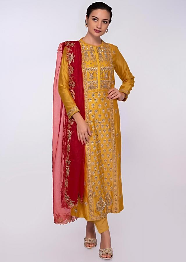 Mustard cotton silk suit in front panel embroidery and side butti only on Kalki