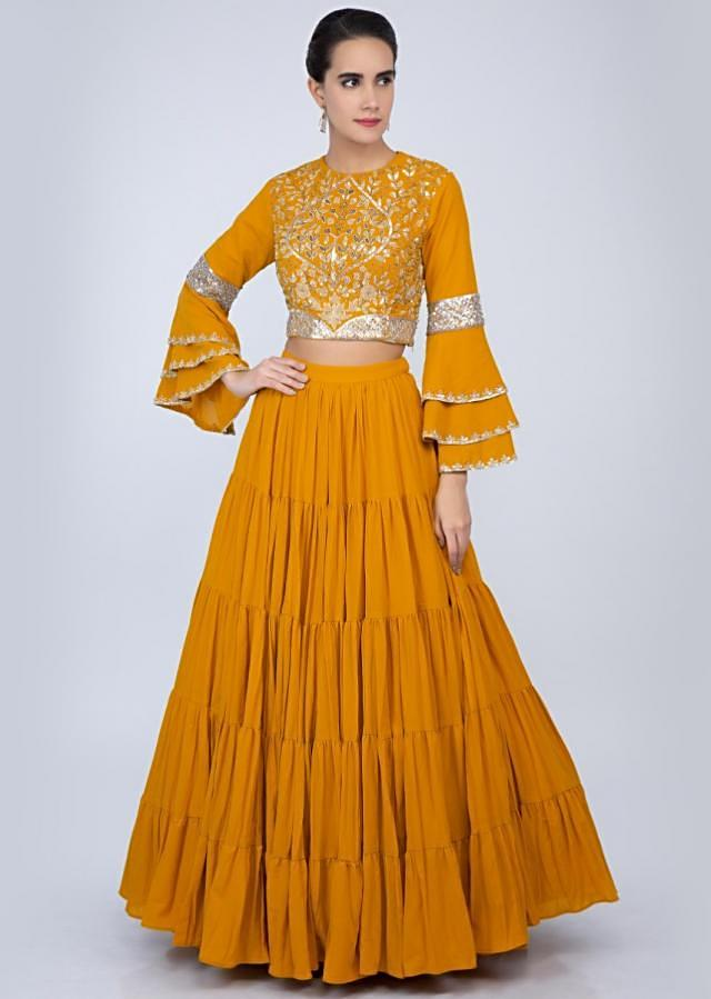 Mustard georgette lehenga with embroidered top and net dupatta only on Kalki