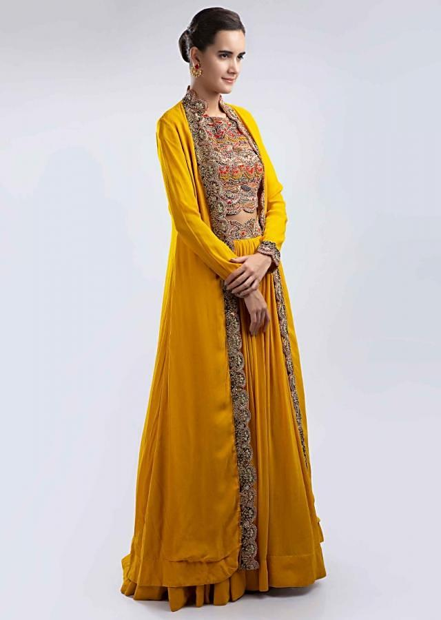 Mustard Lehenga In Georgette With Heavy Embellished Crop Top And A Long Scallop Embroidered Jacket Online - Kalki Fashion