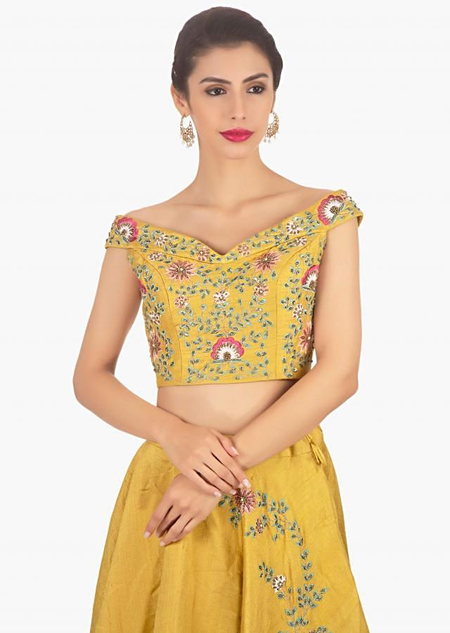 Mustard Lehenga In Raw Silk And Blouse Paired With Pink Net Dupatta Online - Kalki Fashion
