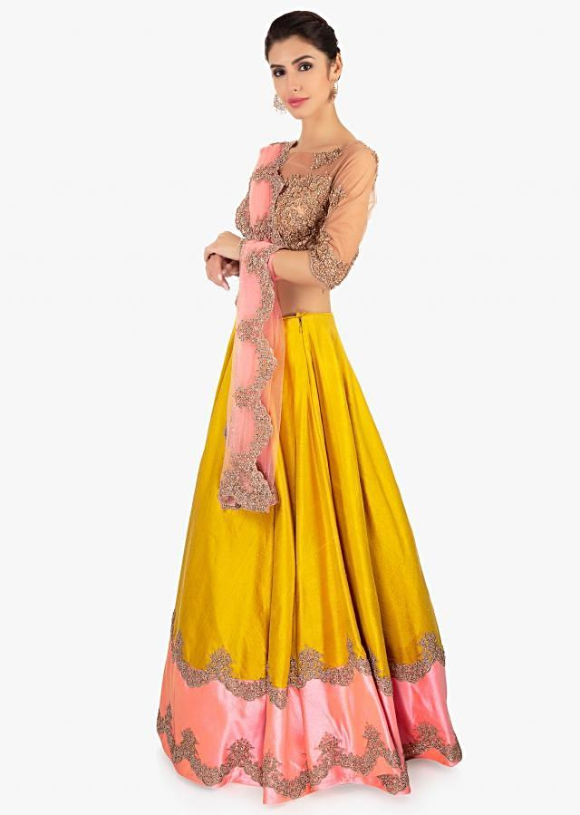 Mustard Lehenga In Raw Silk Paired With A Beige Net Blouse And Pink Net Dupatta Online - Kalki Fashion