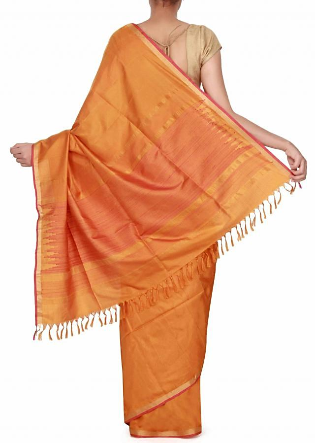 Mustard saree adorn in pink and gold border only on Kalki
