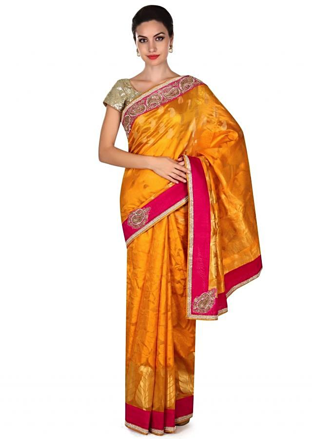 Mustard saree in contrast pink border only on Kalki