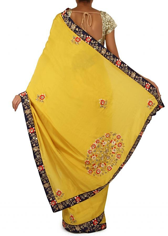 Mustard saree in sequin and thread embroidered border only on Kalki