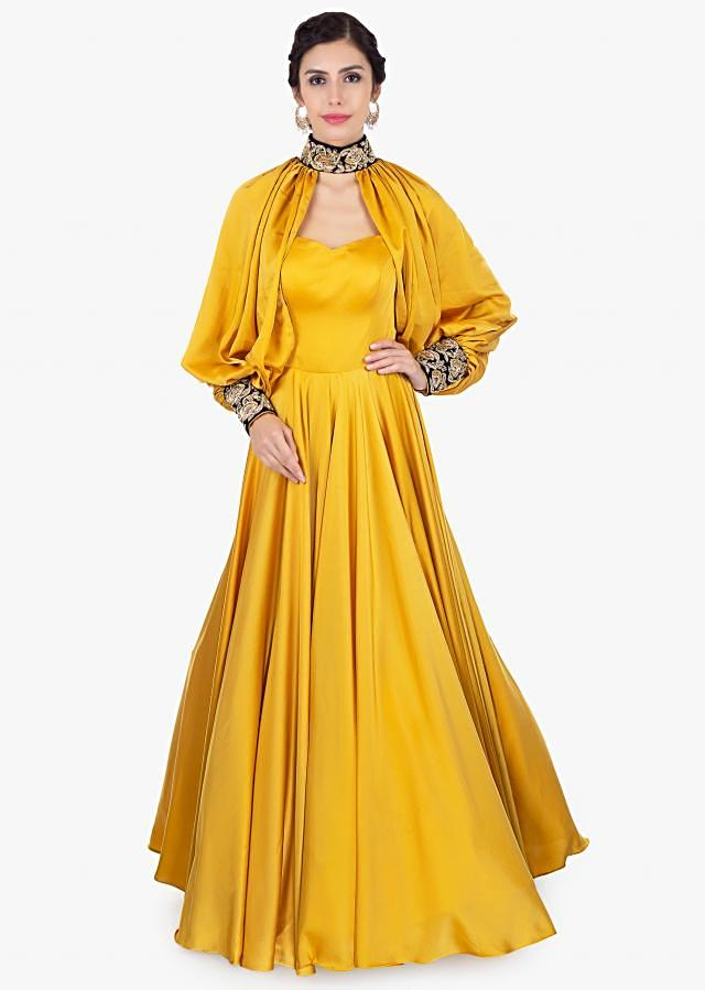 Mustard satin strap gown with additional top layer only on Kalki