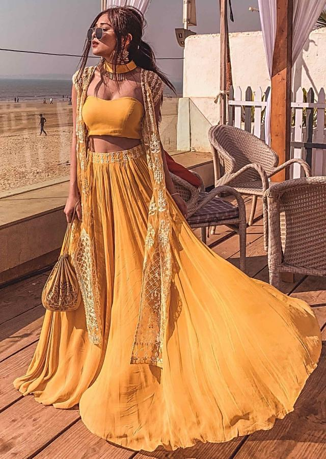 Mustard strapless corset blouse and palazzo with thread embroidered net jacket only on Kalki