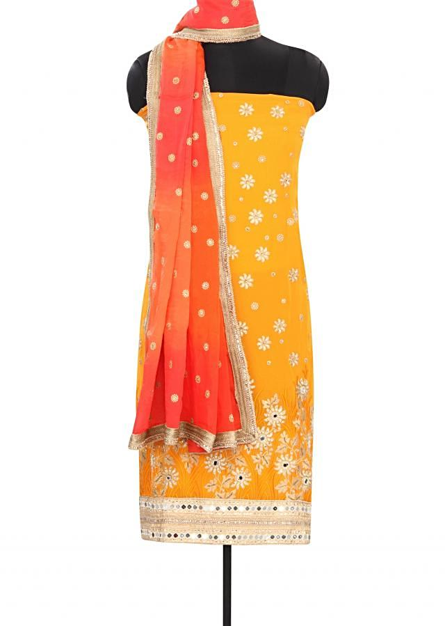 Mustard unstitched suit embellished in resham and mirror embroidery only on Kalki