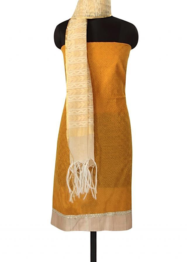 Mustard unstitched suit in thread work all over only on Kalki